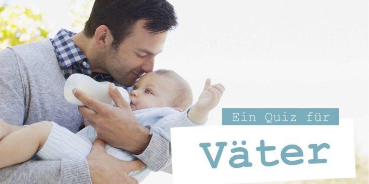 Ein Vater küsst sein Baby während er es mit der Flasche füttert